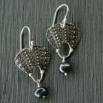 Oxidized sterling silver with the texture of sea urchins, accented with at black pearl.