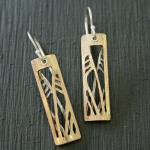 Hand cut  14k GF and sterling silver inspired by silhouettes of willowy sea oats.