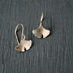 14k gf textured gingko leaves. Earwires are 14k gf.  1/2 inch wide and 3/8 of an inch long