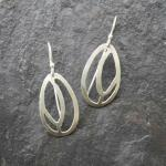 Lady Slippers Hand-cut sterling silver earrings.