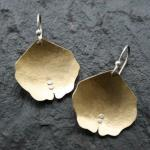 Domed, textured brass with sterling silver accents. $48.00