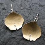 Domed, textured brass with sterling silver accents. $68.00